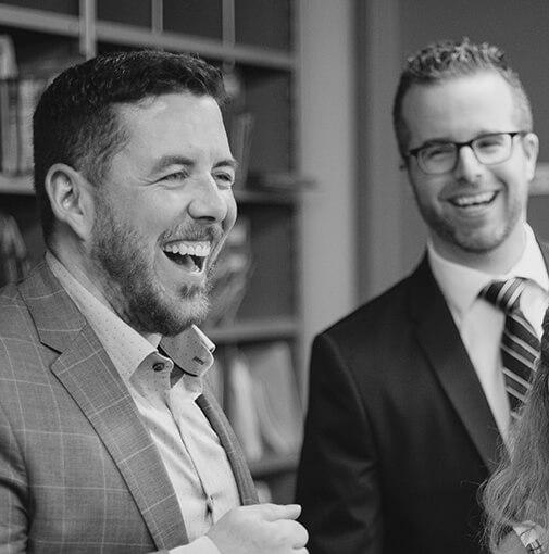 Christian Gemme souriant avec un employé BJC